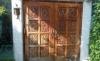 [Before] 焼け、汚れ、傷など経年変化により傷んでしまったチーク材の手彫り無垢の玄関ドア。約30年使用。